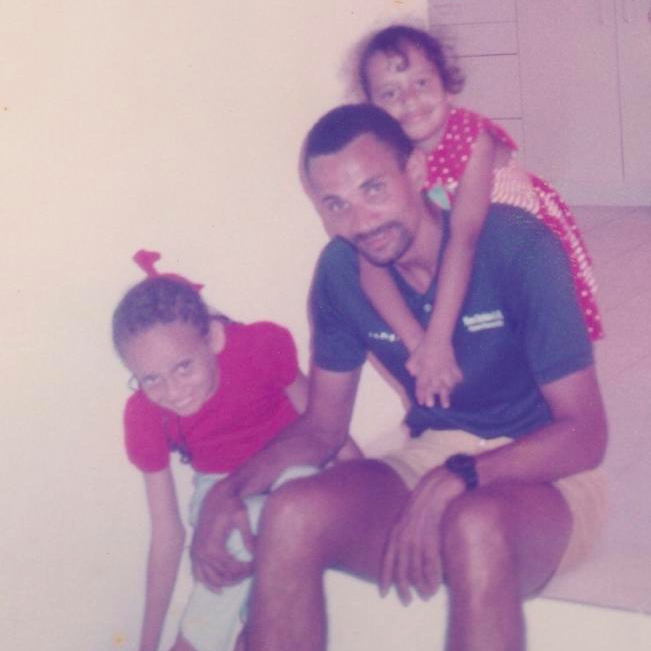 Father with his two daughters.
